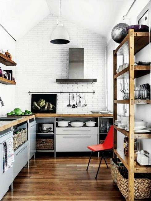 loft-kitchen-open-shelves-wood-floors-wood-countertops-white-walls-hanging-rod-for-utensils