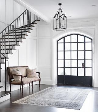 foyer-floor-to-ceiling-wainscoting-arched-front-door-sidelights.jpg