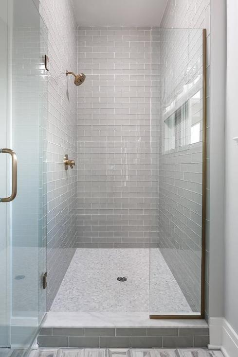 gray-glass-tiles-marble-shower-threshold.jpg